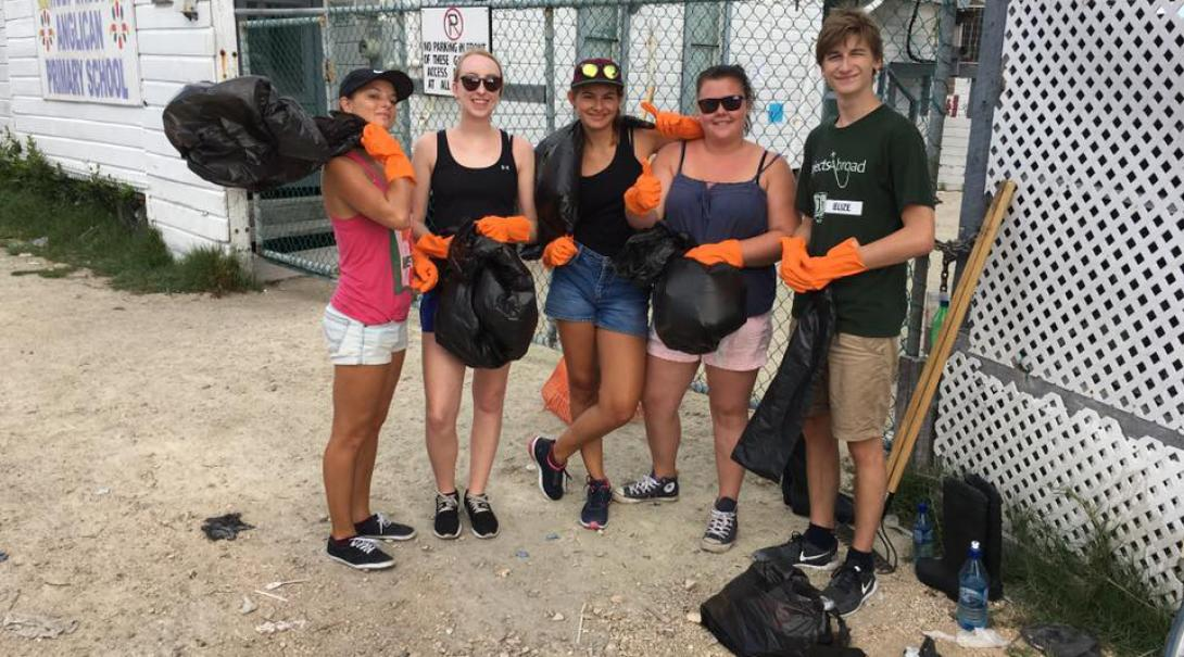 Volunteers take a group photo before picking up litter in the community in belize